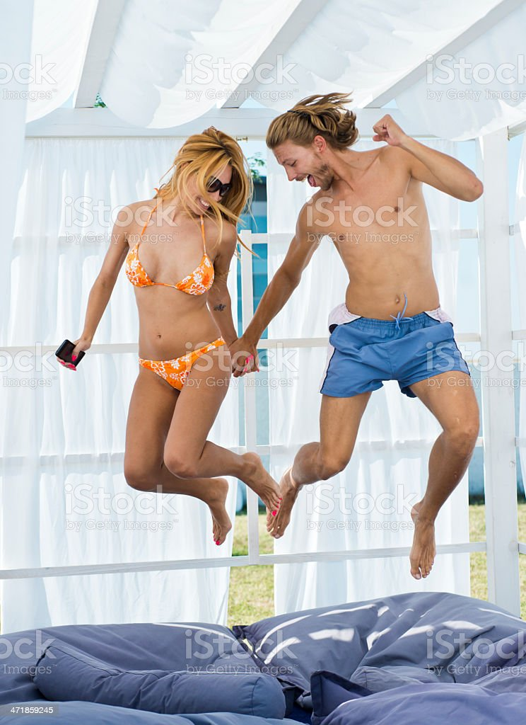 Happy couple jumping stock photo