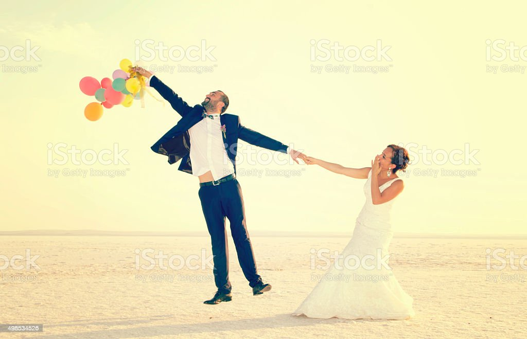 happy couple jumping stock photo