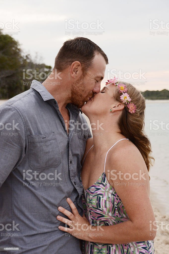 Happy couple kissing each other stock photo