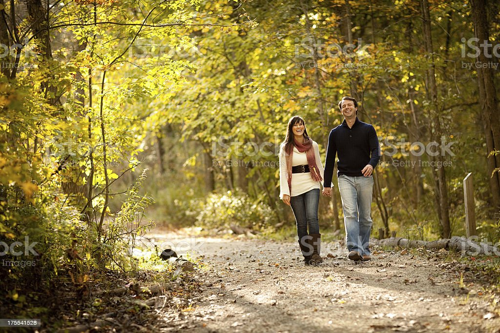 Happy Couple Laughing Together in Autumn Woods royalty-free stock photo