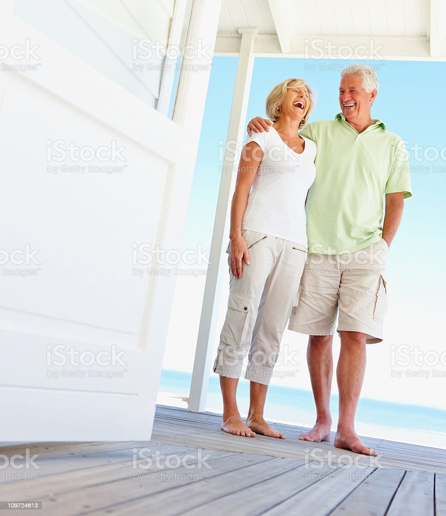 Happy couple laughing together on a vacation royalty-free stock photo