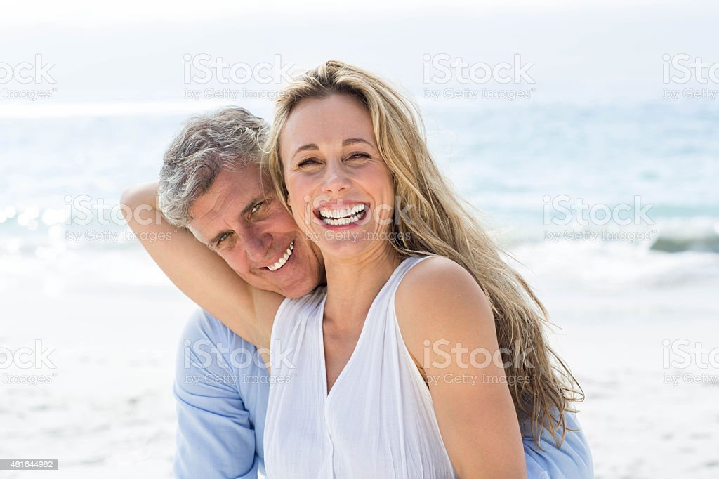 Happy couple laughing together stock photo