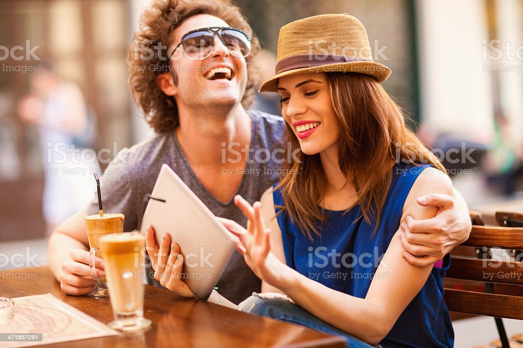 Happy couple  looking at digital tablet royalty-free stock photo
