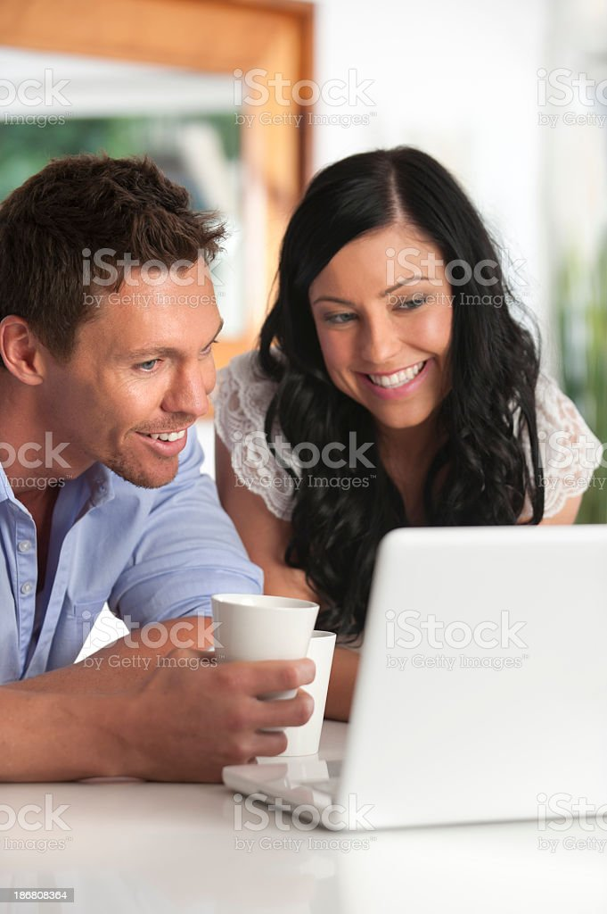 Happy Couple looking at laptop computer royalty-free stock photo