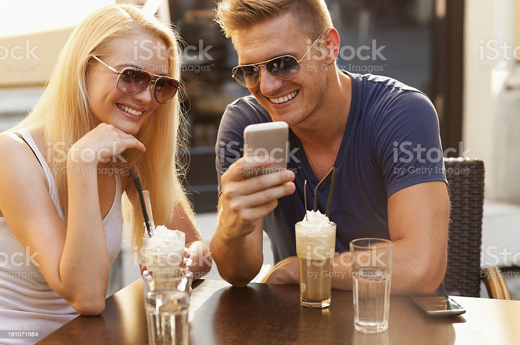 Happy couple  looking at mobile phone royalty-free stock photo