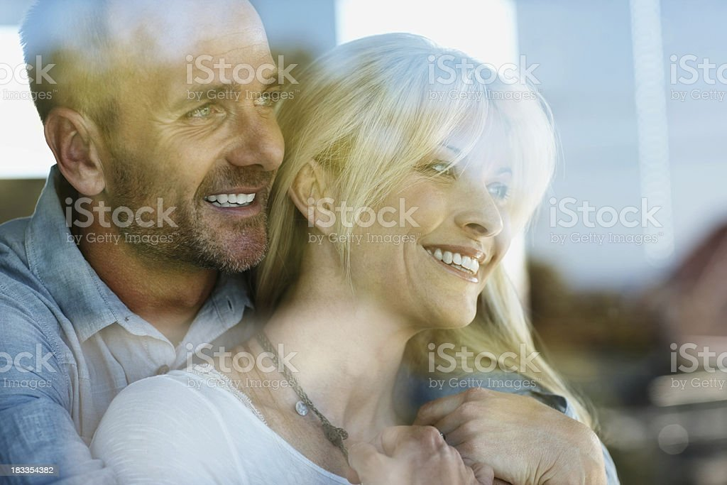 Happy couple looking out royalty-free stock photo