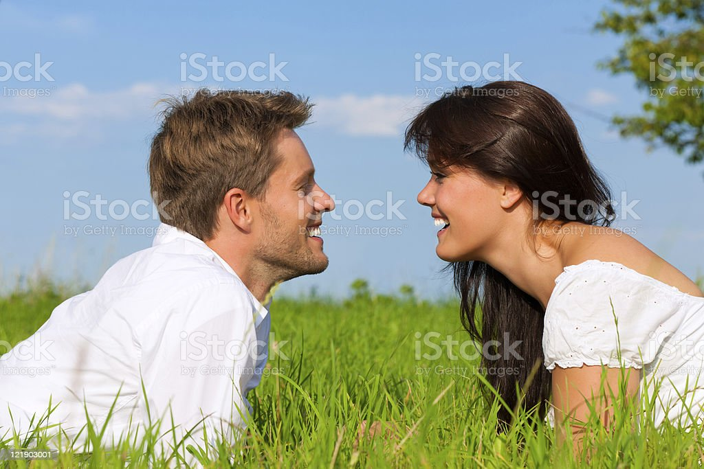 Happy couple lying on a meadow royalty-free stock photo