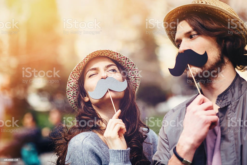 Happy couple making fun stock photo