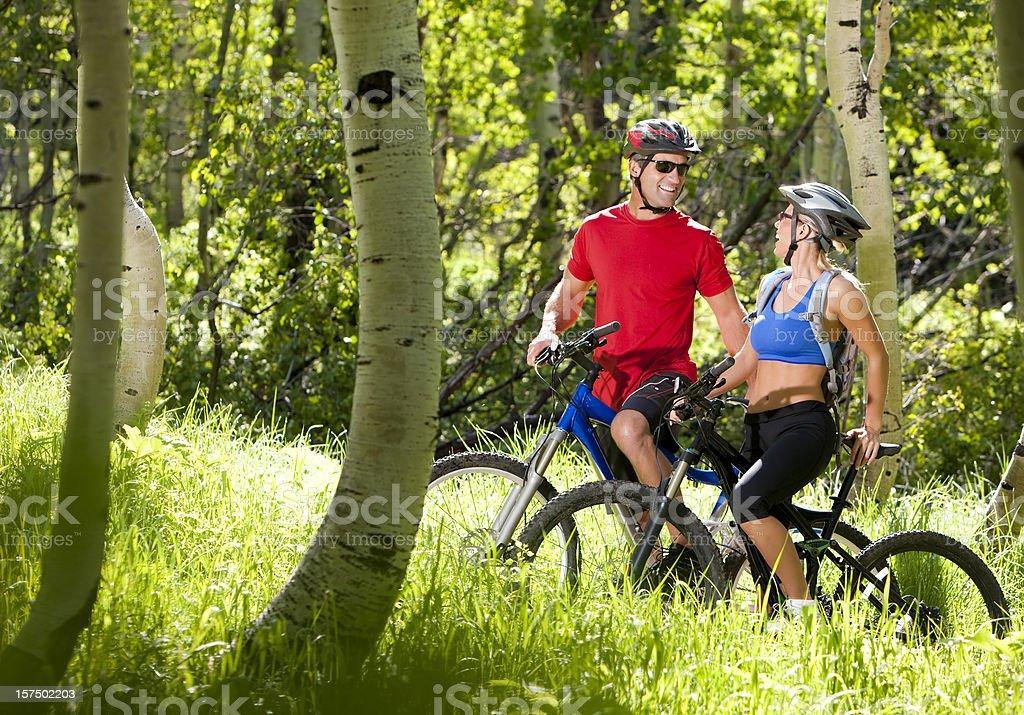 Happy Couple Mountain Biking royalty-free stock photo