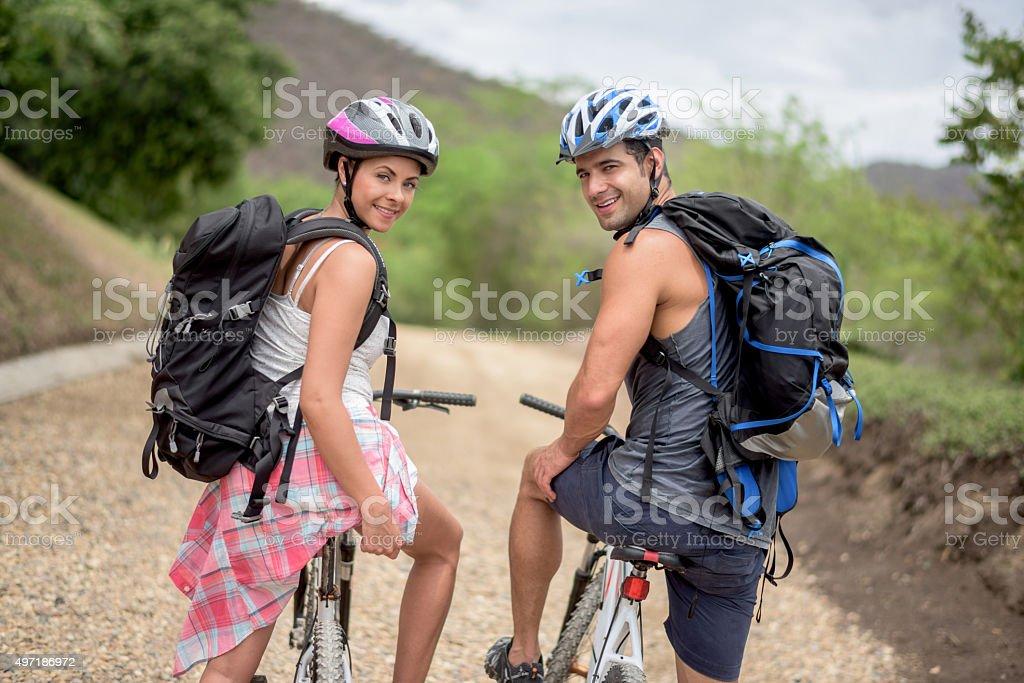 Happy couple mountain biking stock photo