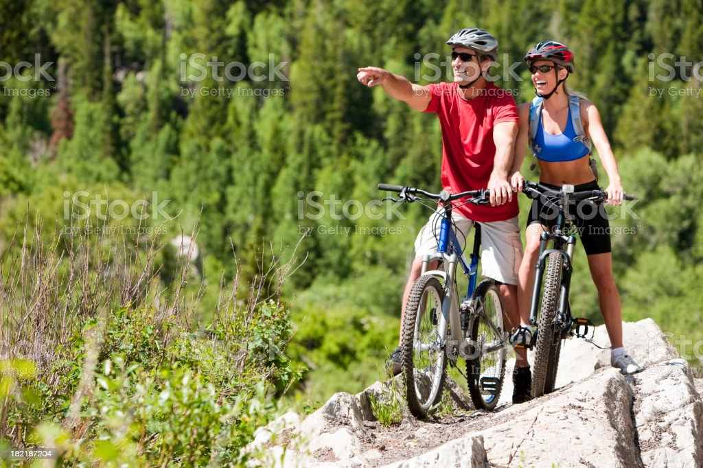 Happy Couple Mountain Biking Together royalty-free stock photo