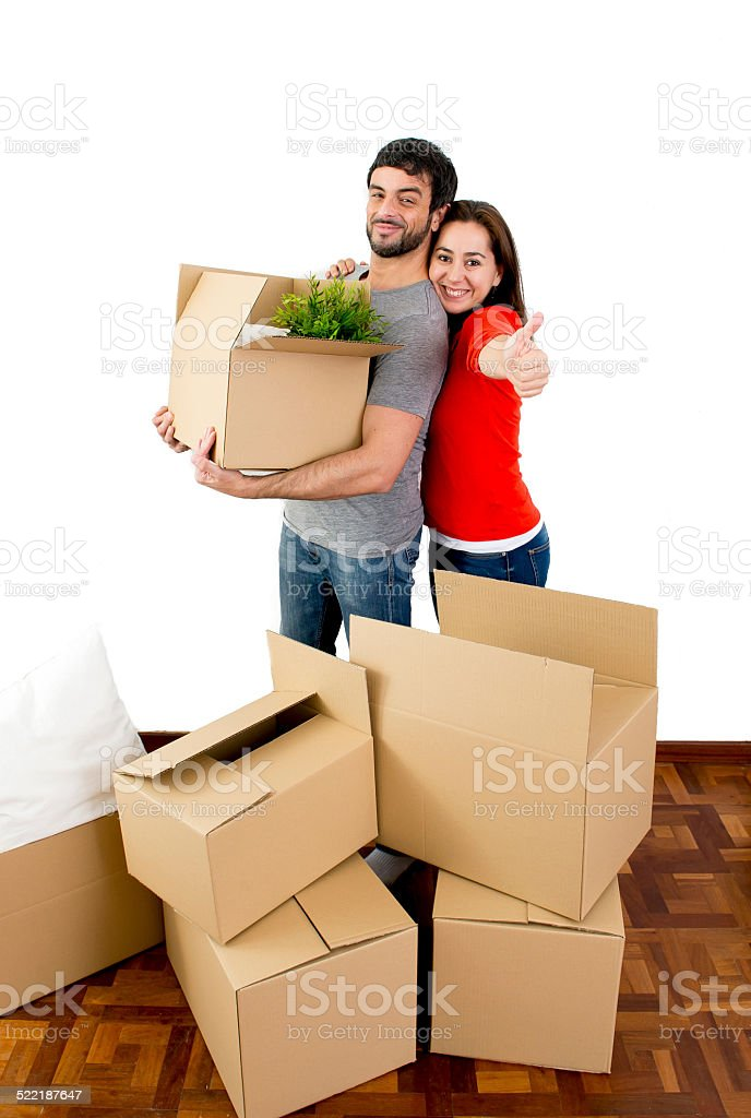 happy couple moving in new flat unpacking cardboard boxes stock photo