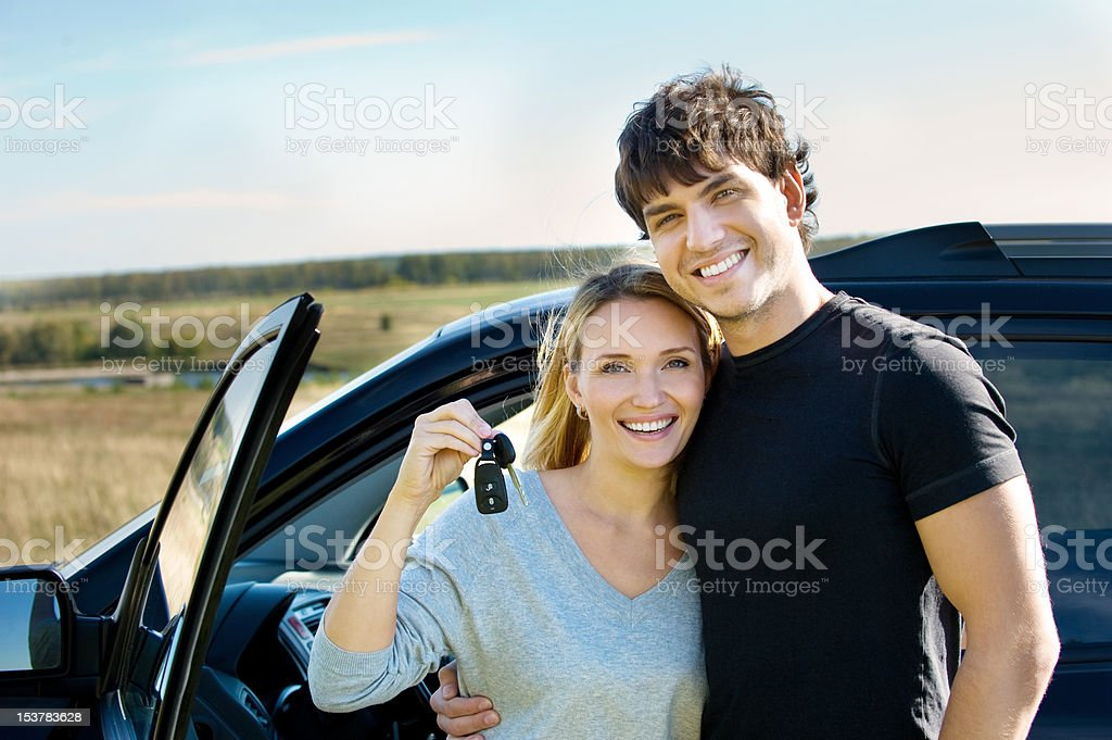 Happy couple near new car stock photo