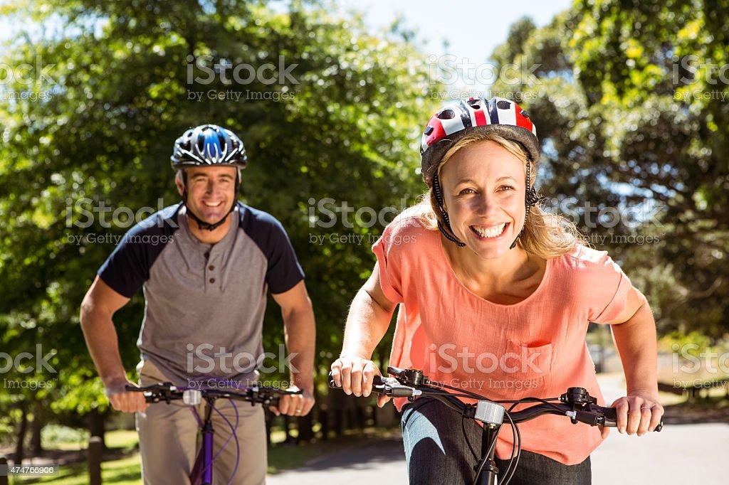 Happy couple on a bike ride stock photo