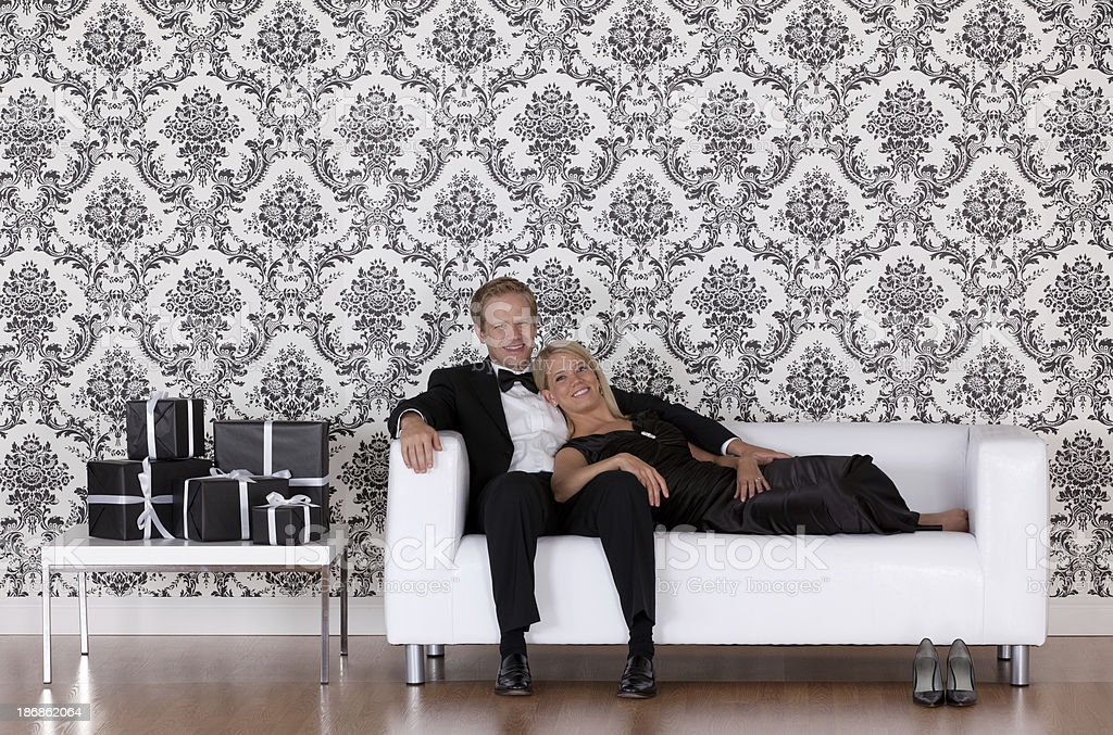 Happy couple on a couch royalty-free stock photo
