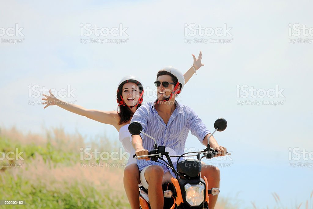 Happy couple on a scooter stock photo