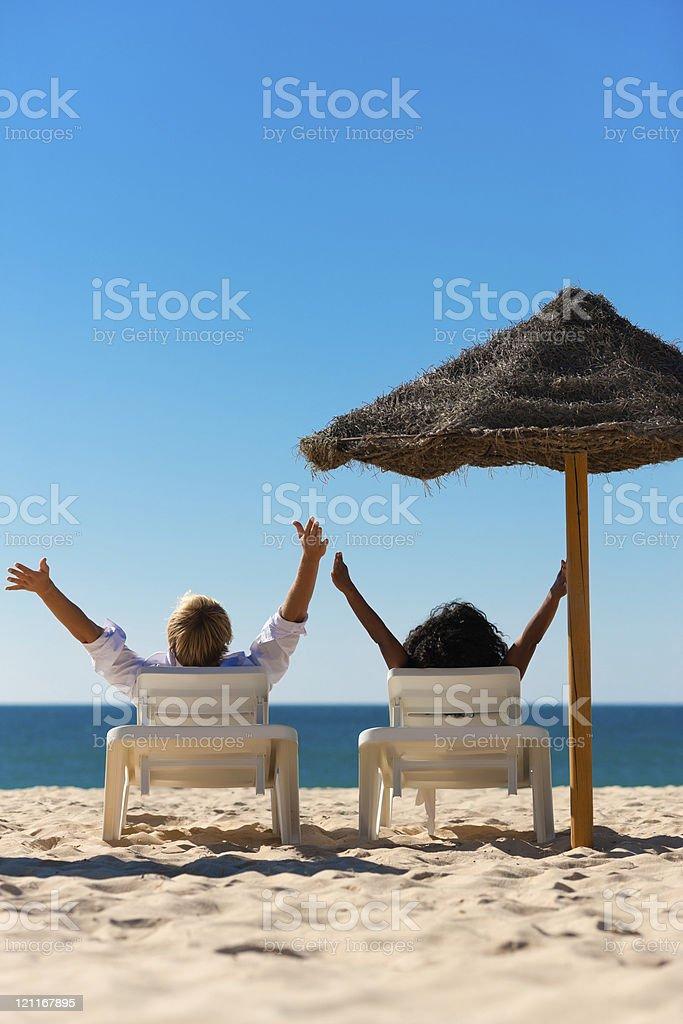 Happy couple on beach royalty-free stock photo