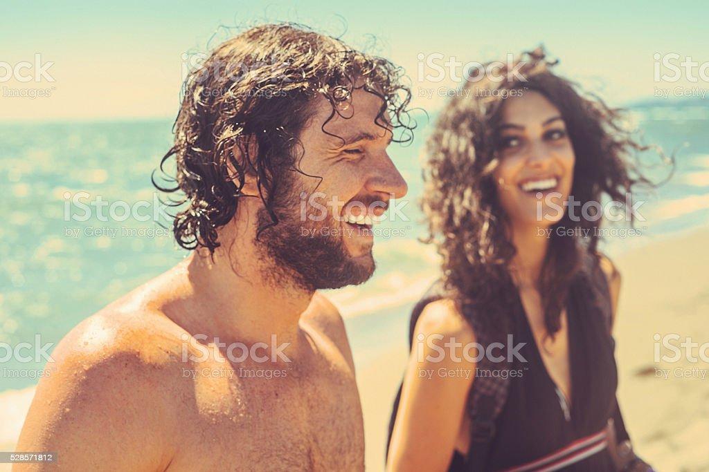 Happy couple on beach stock photo