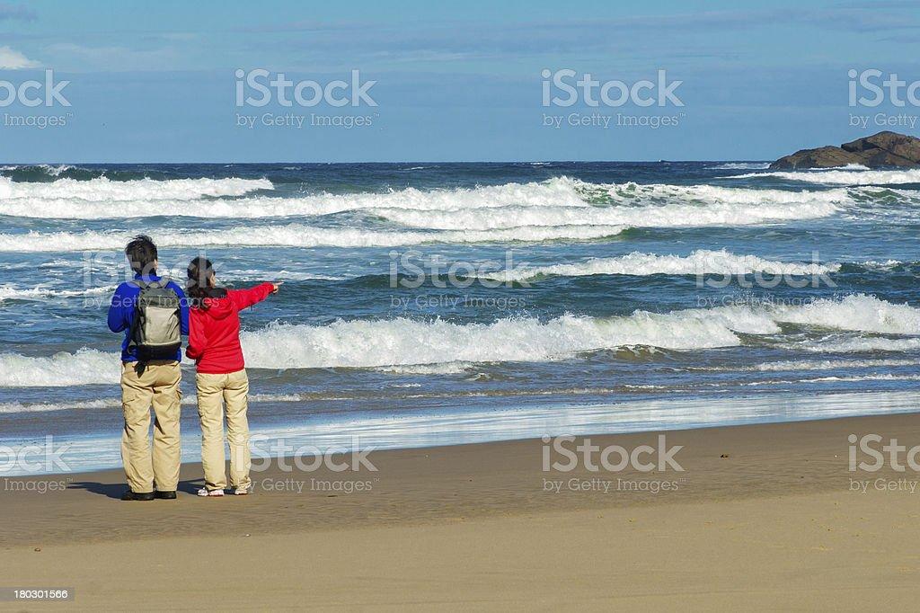 Happy couple on beautiful ocean beach stock photo