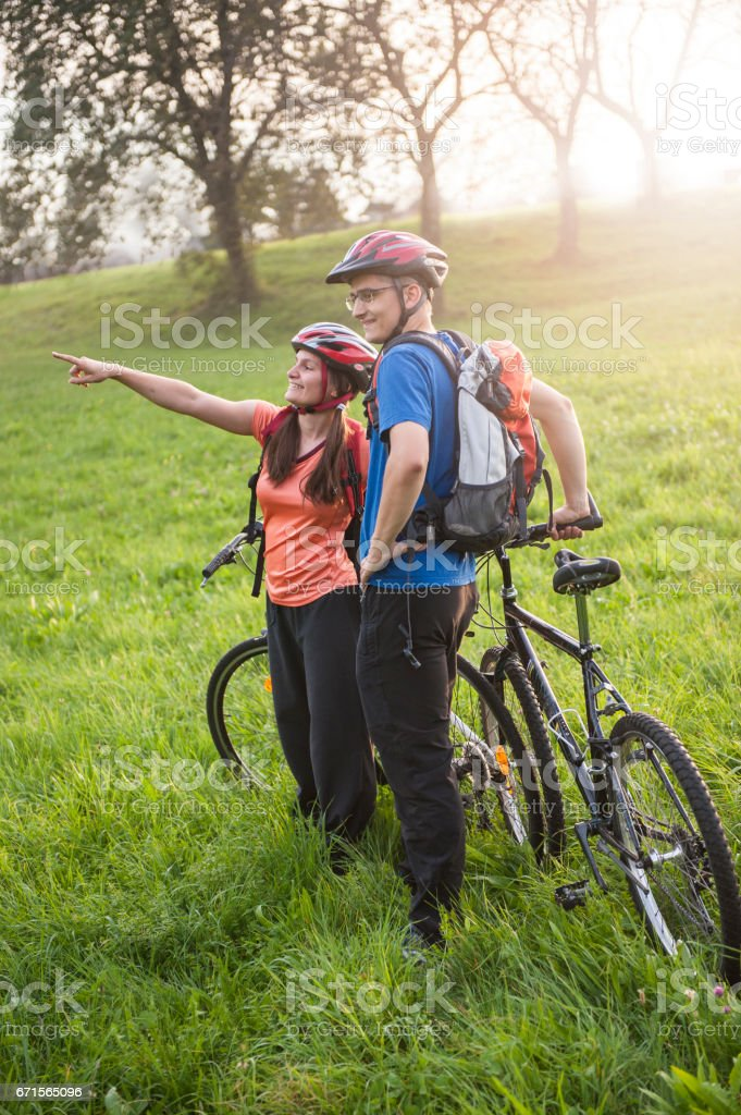 Happy couple on bicycles stock photo