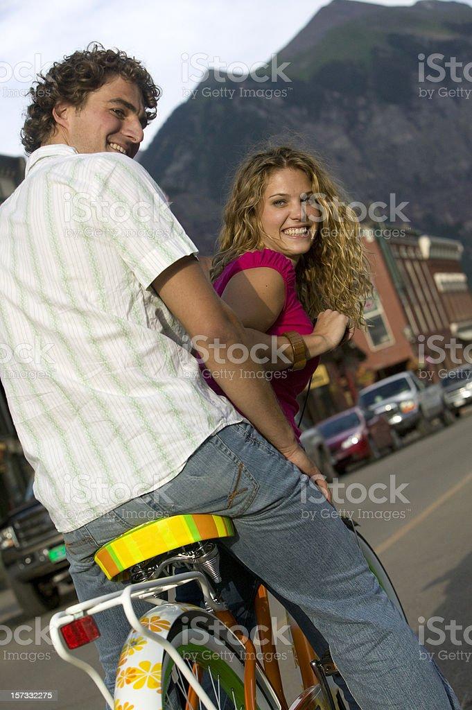 Happy Couple on cruiser style bicycle royalty-free stock photo