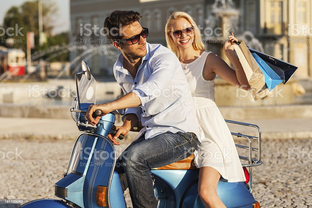 Happy couple on scooter royalty-free stock photo
