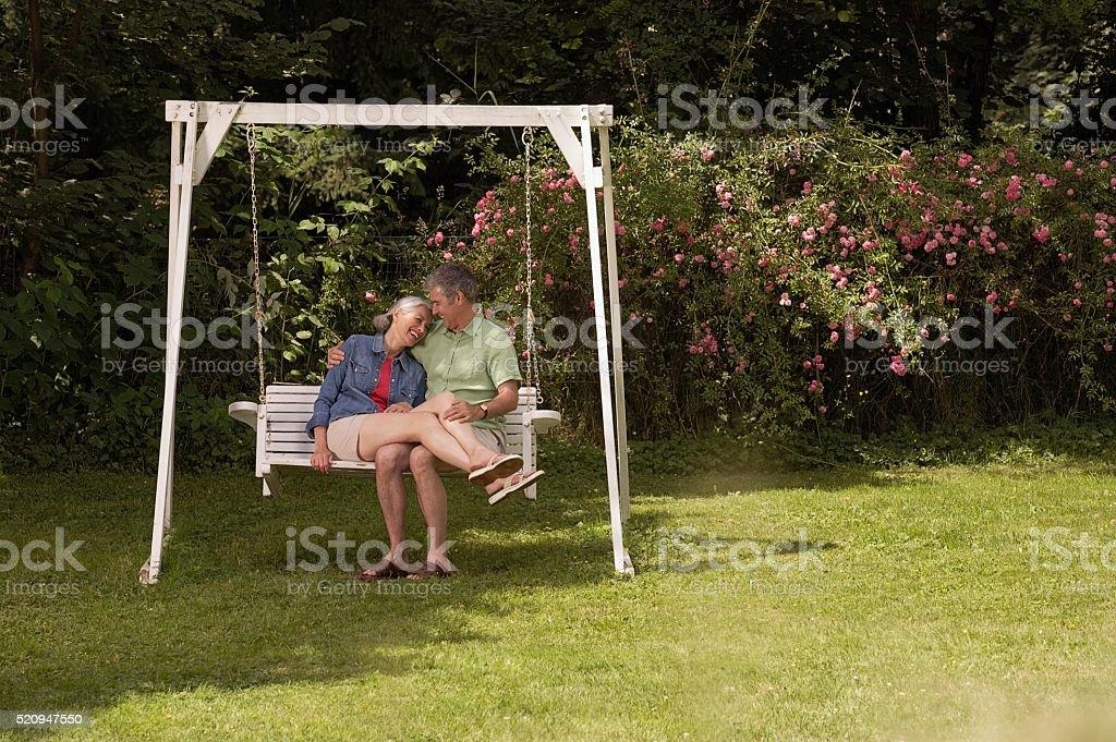 Happy couple on swing stock photo