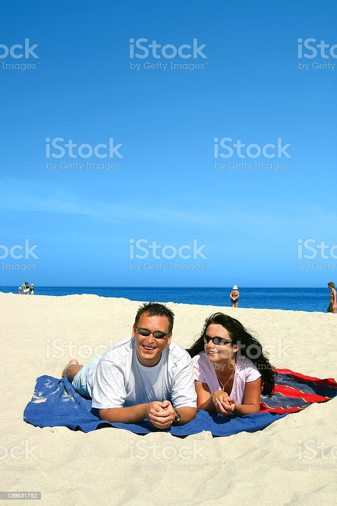 Happy Couple On The Beach royalty-free stock photo