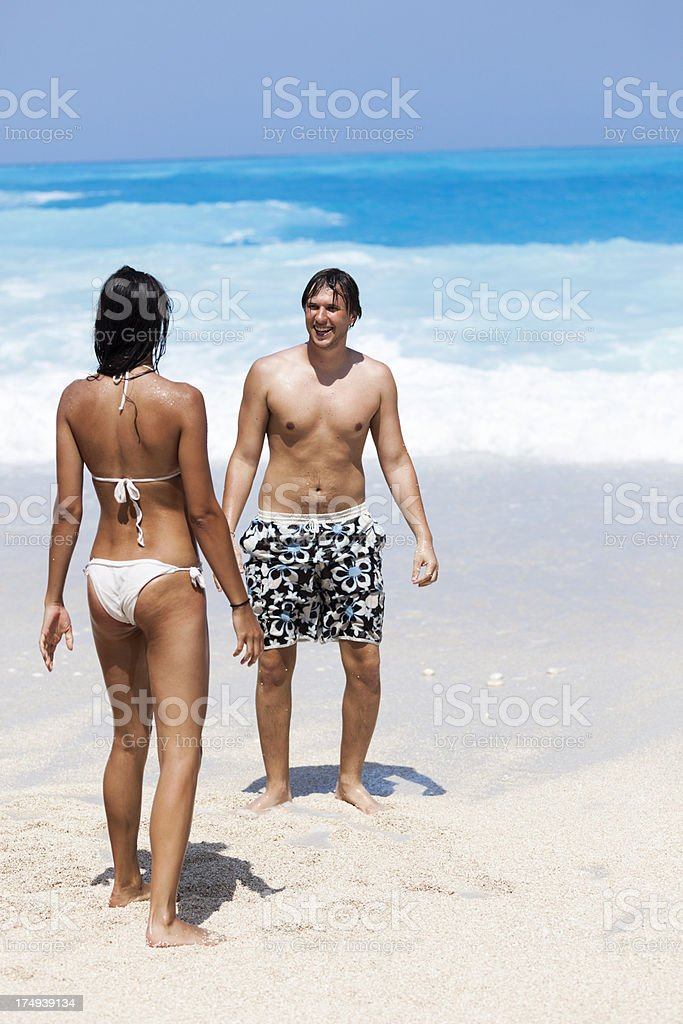 Happy couple on the beach royalty-free stock photo