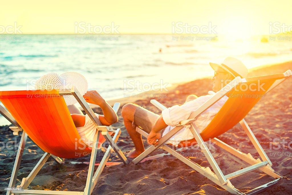 Happy couple on the beach stock photo