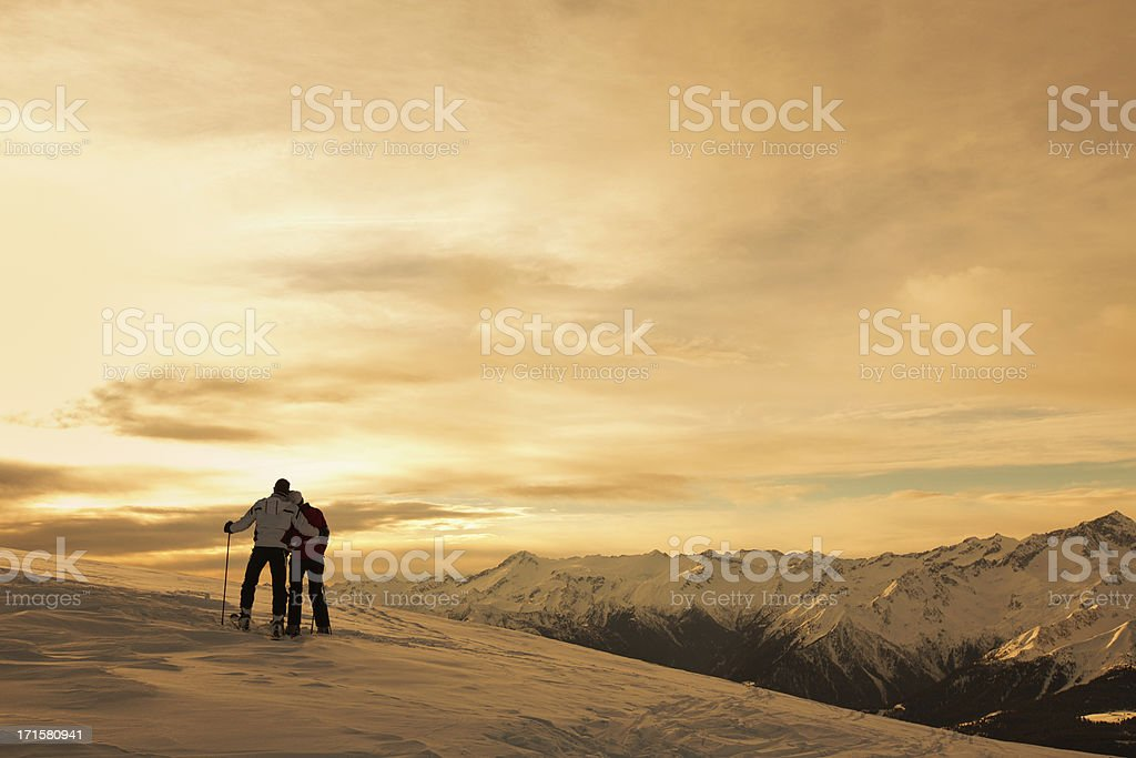 Happy couple on the mountain top royalty-free stock photo