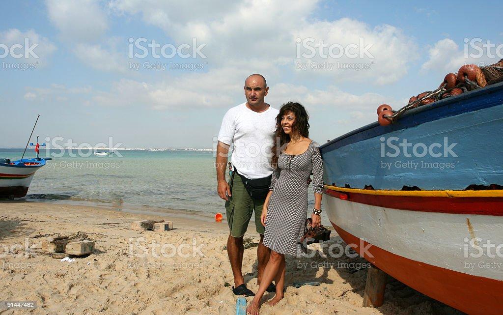 Happy couple on the tunisian beach royalty-free stock photo