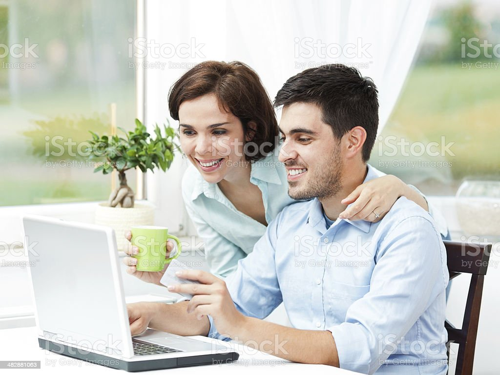 Happy couple online shopping royalty-free stock photo