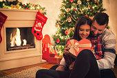 Happy Couple Opening Christmas Presents