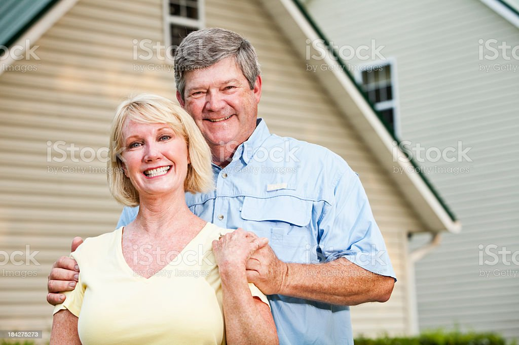 Happy couple outside home stock photo