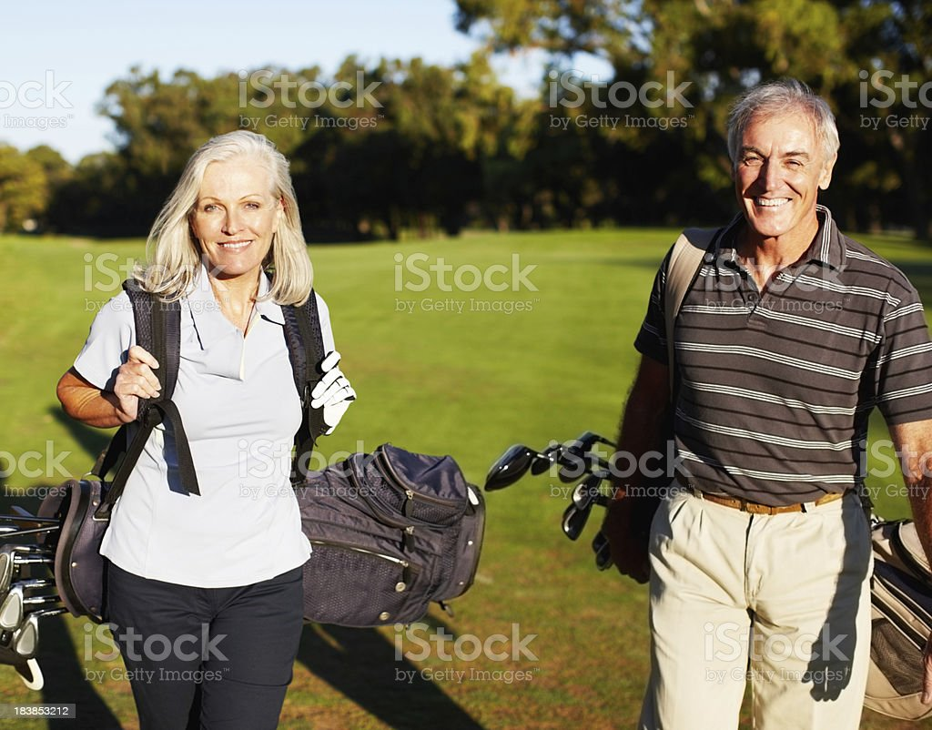 Happy couple playing golf royalty-free stock photo