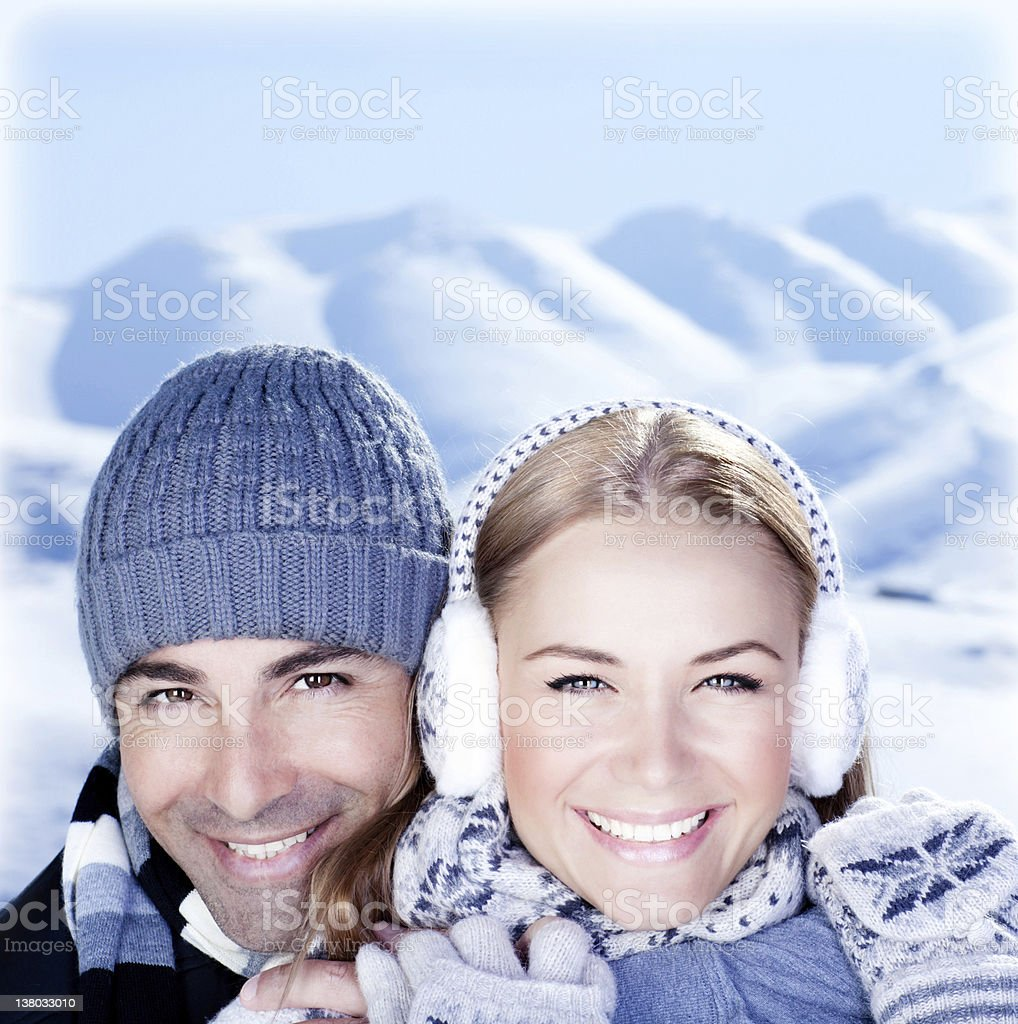 Happy couple playing outdoor at winter mountains royalty-free stock photo
