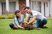 Happy couple playing with their adopted dog