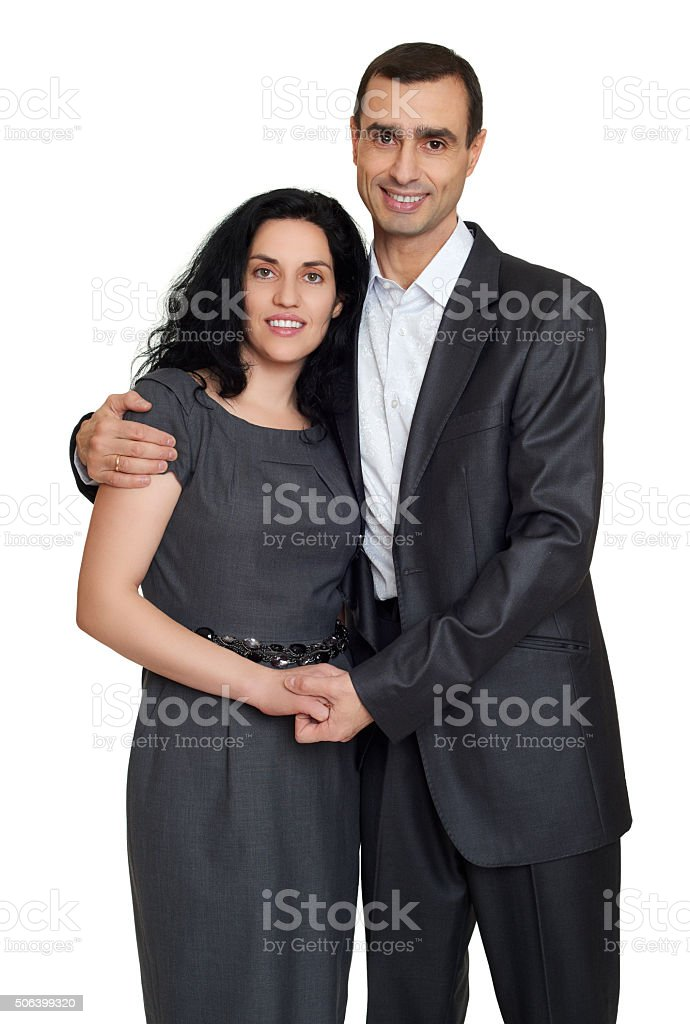 Happy couple portrait at studio dressed in classic clothes stock photo