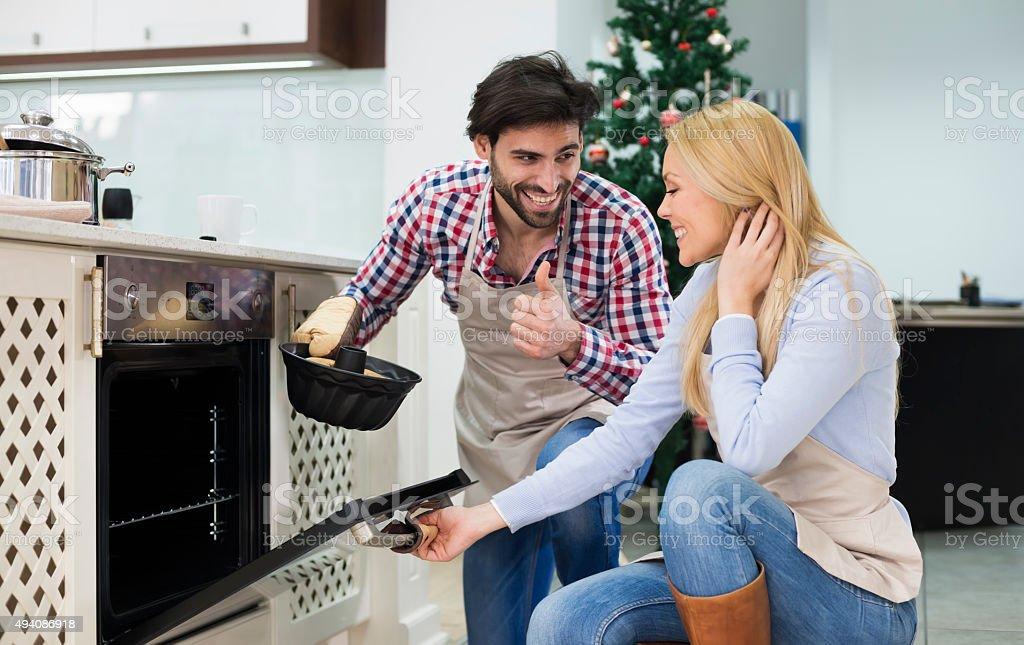 Happy couple preparing  cake for Christmas - Kugelhupf stock photo
