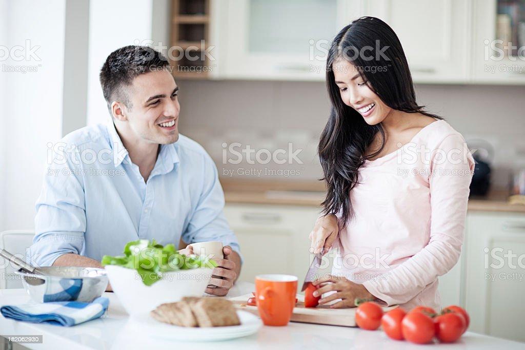 Happy Couple Preparing Meal stock photo