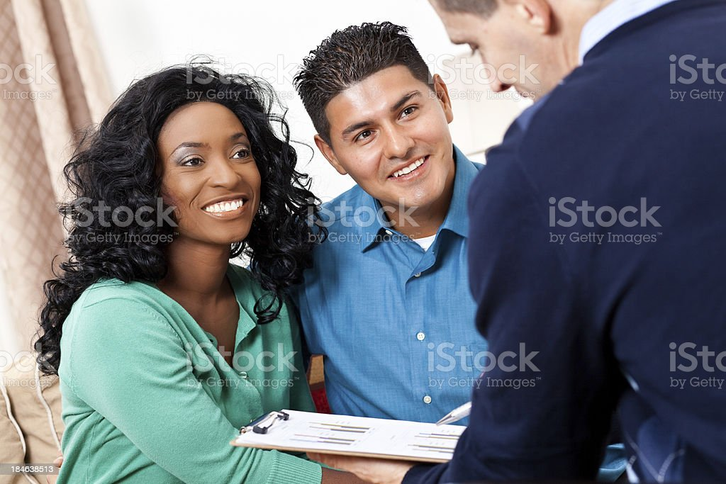 Happy couple receiving advice from financial counselor royalty-free stock photo