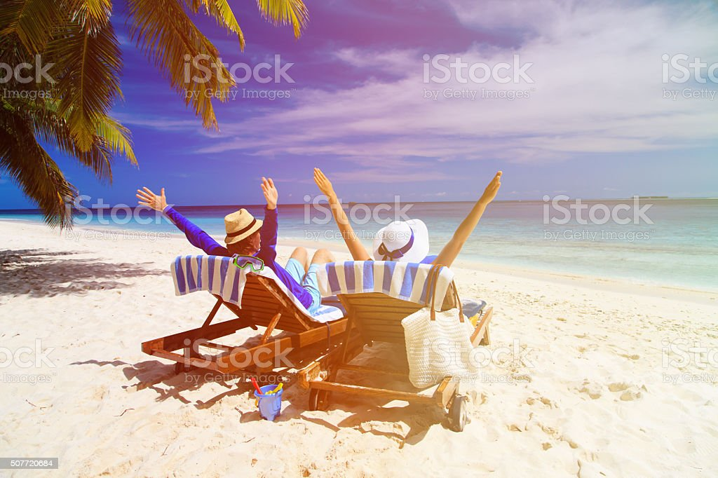 happy couple relax on a tropical beach stock photo