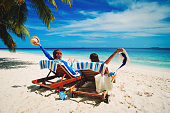 happy couple relax on beach
