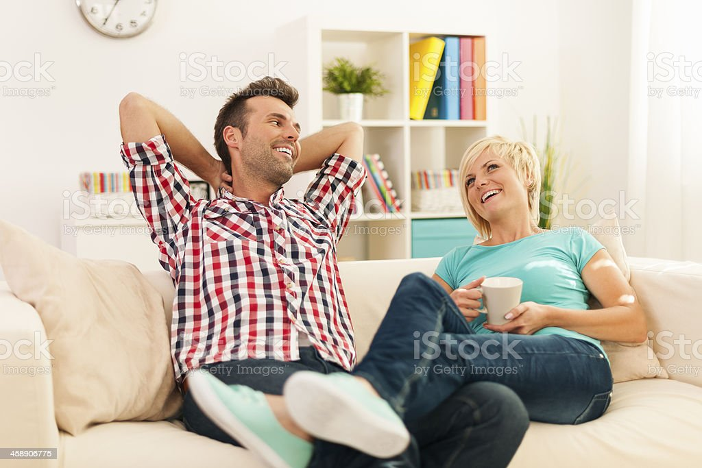 Happy couple relaxing in living room royalty-free stock photo