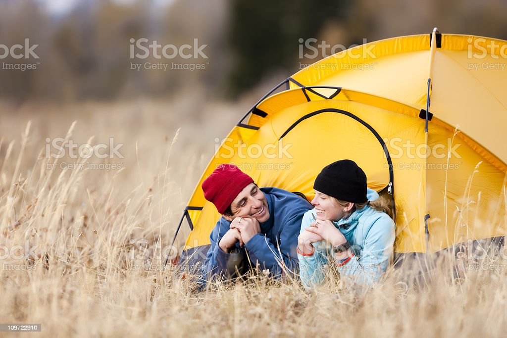 Happy Couple Relaxing in Tent stock photo