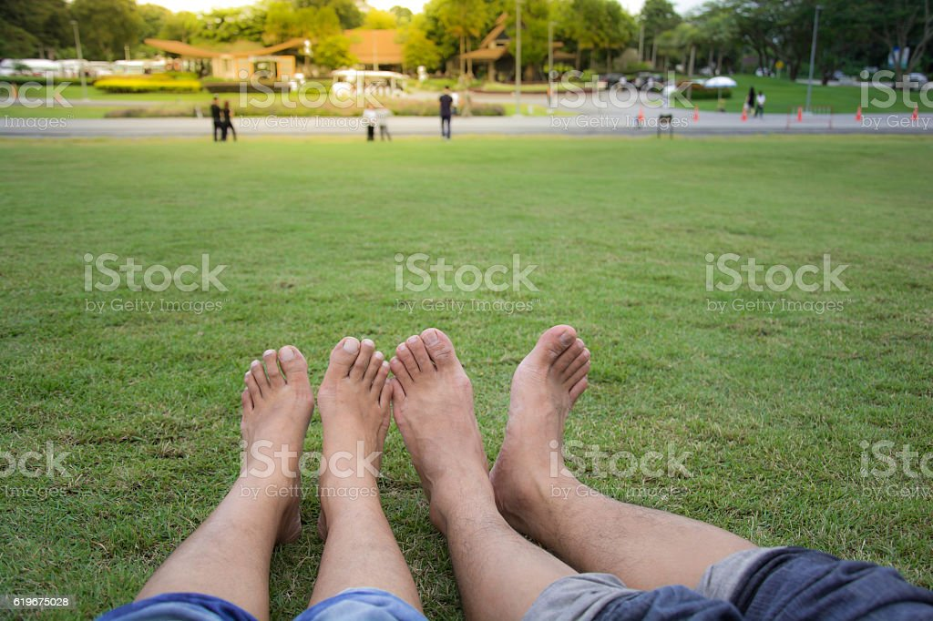 Happy couple relaxing on green grass. Spring park. royalty-free stock photo