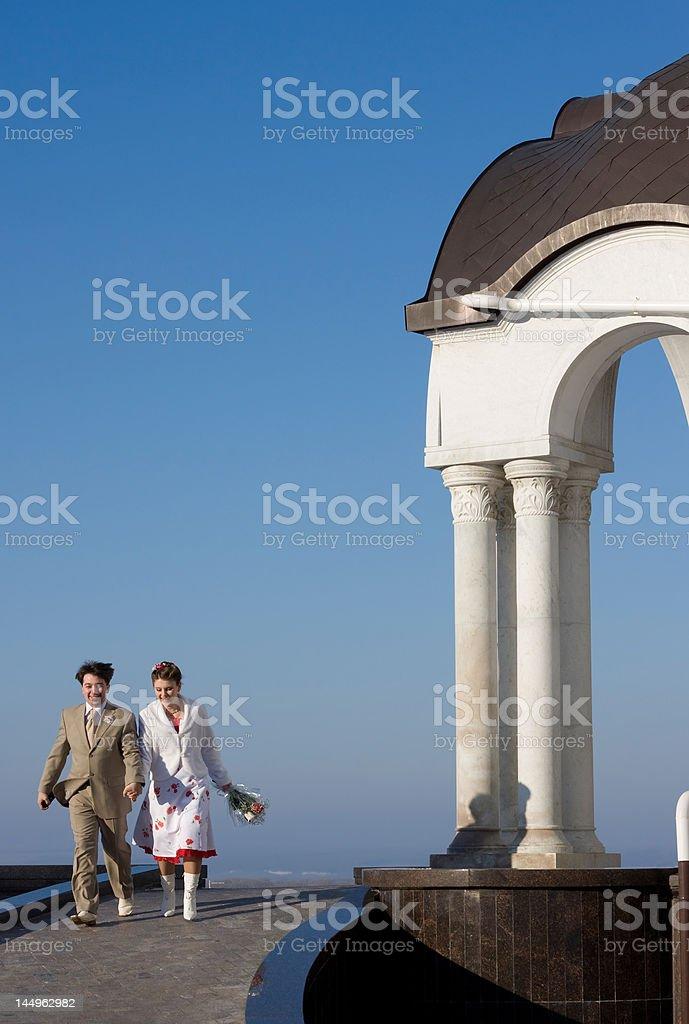 Happy couple running royalty-free stock photo