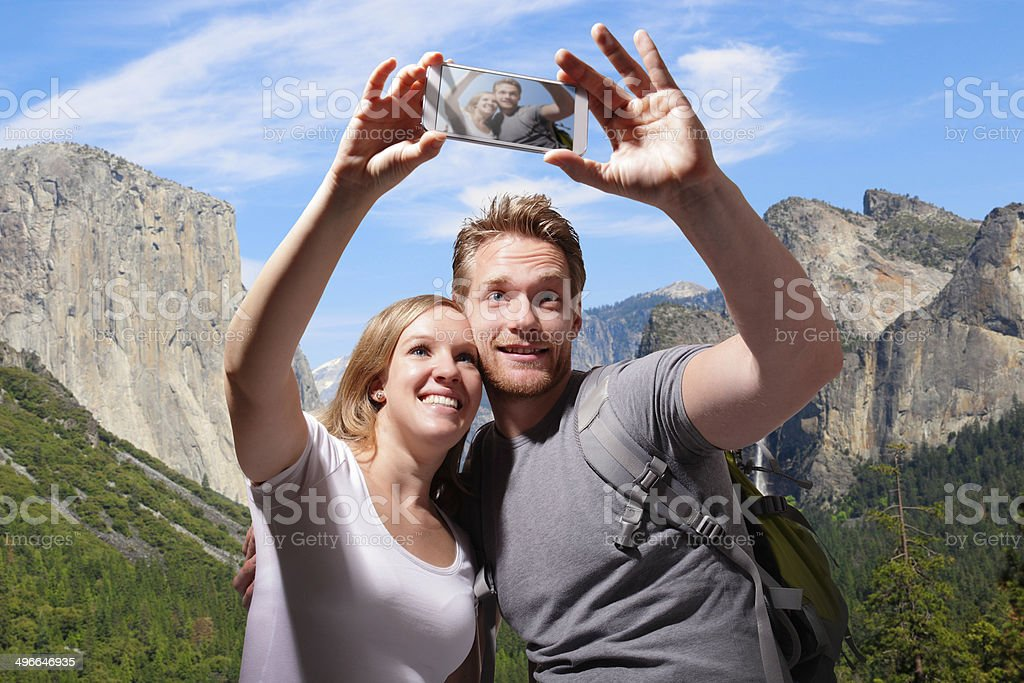 happy couple selfie in yosemite royalty-free stock photo