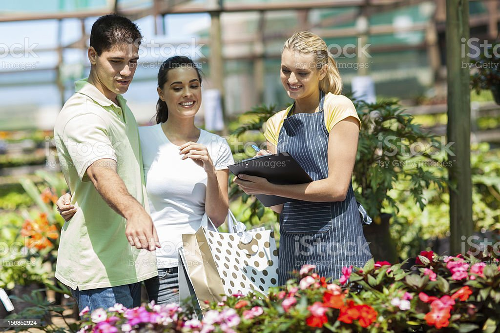 happy couple shopping for plants royalty-free stock photo